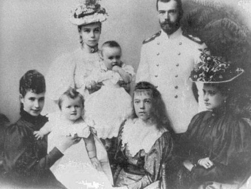 Nicholas and Alexandra, both on the right, with some of Nicholas' family.  Front Row:  Nicholas' mother, Dowager Empress Marie Alexandrovna, holding Grand Duchess Olga, and Grand Duchess Olga Alexandrovna, Nicholas' baby sister.  Back Row:  Grand Duchess Xenia, the oldest of Nicholas' 2 sisters, holding her daughter Princess Irina.