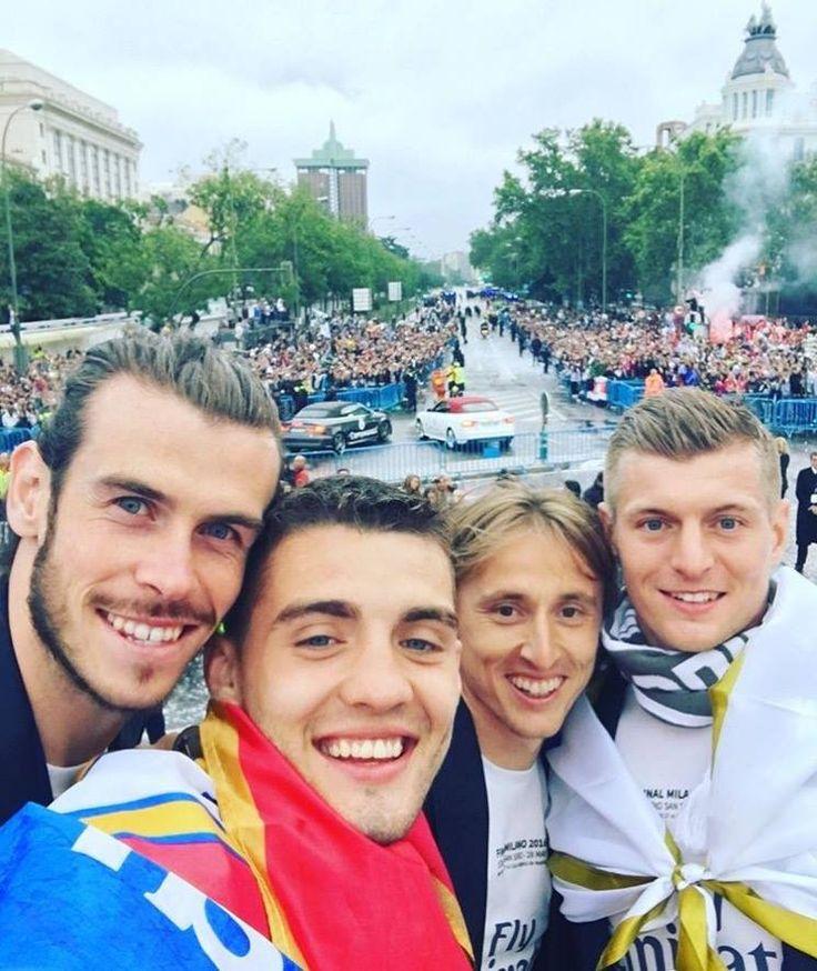 #LaUndecima   Gareth Bale  Mateo Kovačić  Luka Modric... See More — celebrating La Undécima at Plaza de Cibeles.