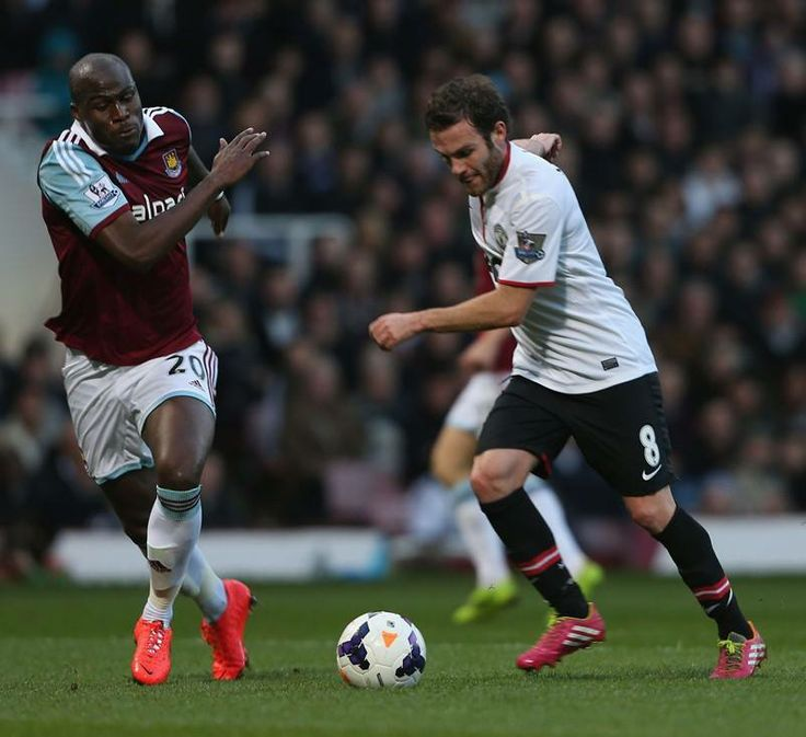 Juan Mata attempts to burst past Guy Demel.