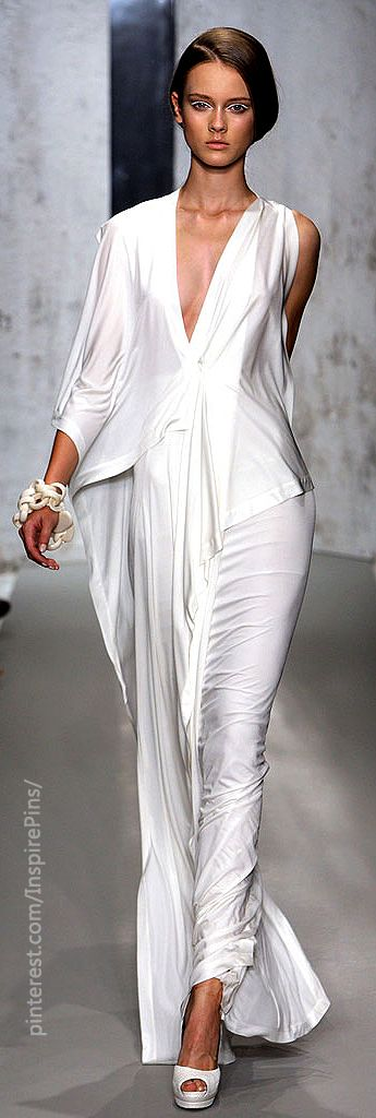 Spring 2010 Donna Karan white shimmer sultry silky design folds draping and light train and sleeues unique, ill take it but NOT the shoes. please