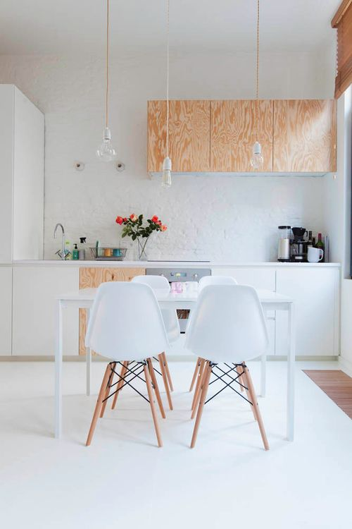Ply and white cabinets, with white flooring....