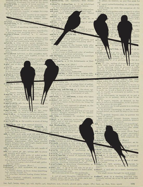 Bird silhouettes printed on a page from a dictionary or book