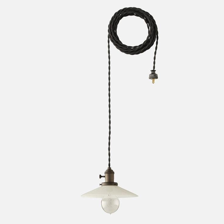"""Apartment Pendant 2.25"""" This vintage-inspired pendant recalls the classic lines and raw beauty of early 20th century industrial design. Thoughtful details including a braided black cloth cord and Bakelite plug finish off this Schoolhouse Electric Original. Built with a 2.25"""" fitter to accommodate glass or metal shades. Includes 20 feet of black twisted cord."""