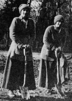 Grand Duchesses Tatiana and Anastasia digging in the garden while under house arrest in 1917.
