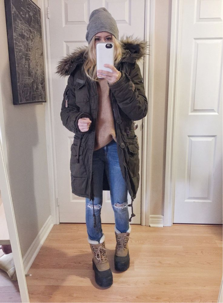 Khaki green winter parka+camel sweater+grey knit beanie+skinny jeans+camel and black sorels or winter boots. Winter Casual Outfit 2017-2018