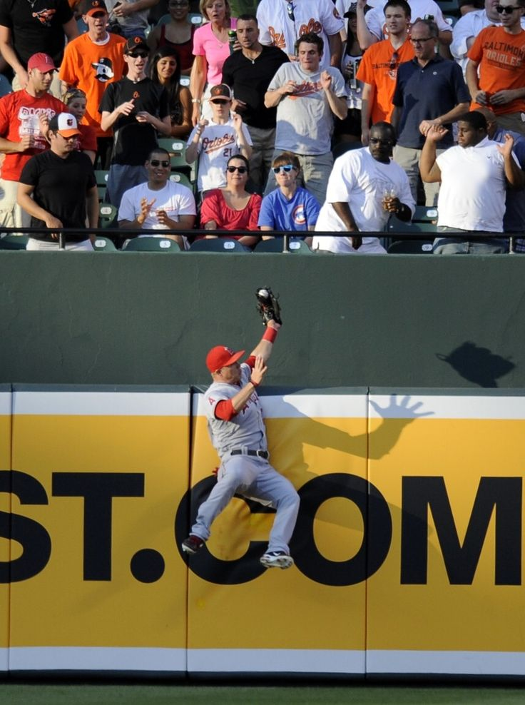 Los Angeles Angels center fielder Mike Trout catches a fly ball by Baltimore Orioles' J.J. Hardy during the first inning of a baseball game on Wednesday, June 27, 2012, in Baltimore. (AP Photo/Nick Wass)