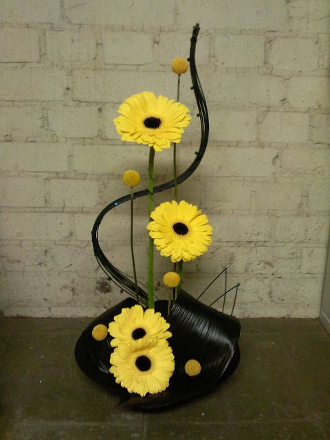 Theatre foyer arrangement with Gerberas - influenced by the west end show CATS | Naomi56