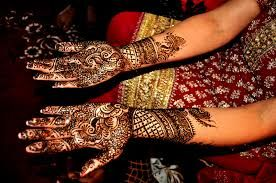 Among the many traditions that are infused into Indian weddings, one of the most prominent is the mehndi ceremony.It is a common belief that the darker the color the mehndi leaves on the hands on a bride, the more will she be loved by her husband and mother-in-law.  Although these beliefs make the application of mehndi a much anticipated and charming tradition, the actual reason is of much deeper significance, which is sometimes forgotten in the present day.