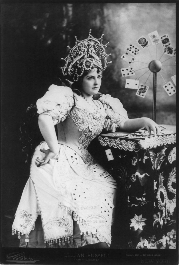 "Sarony, Napolean. ""Lillian Russell, 1861-1922, three-quarters length, seated, facing right; with cards at table, in the ""Tzigane"" (fortune teller)."" Circa 1895."