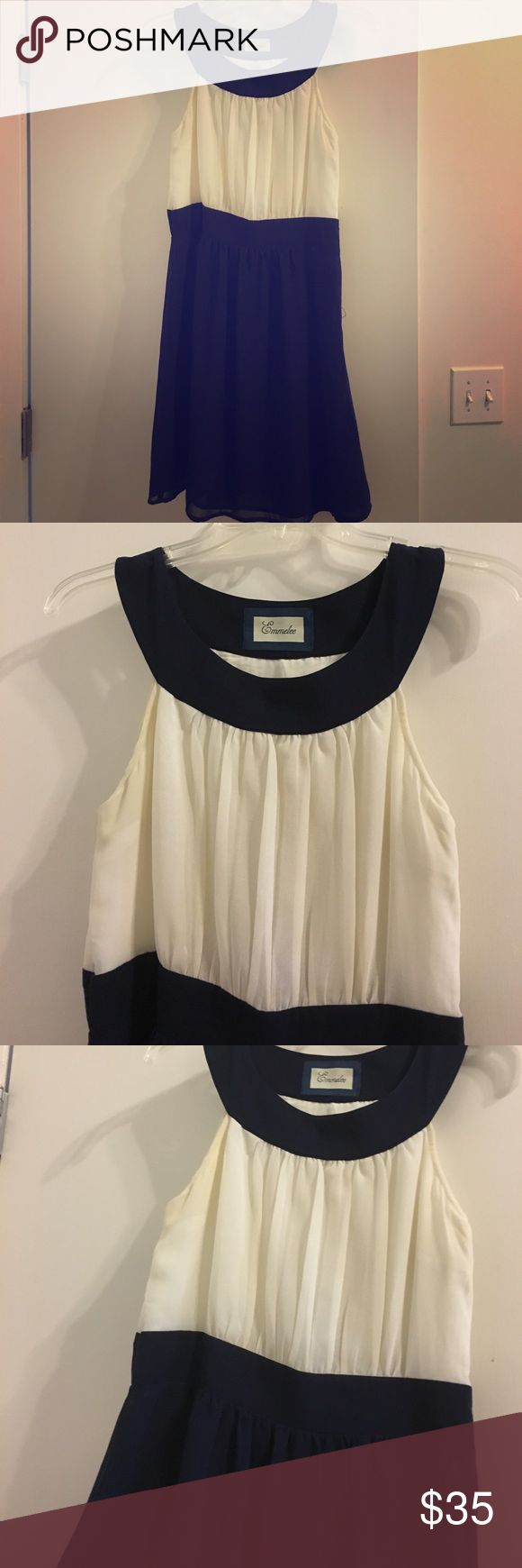Francesca's grecian blue and white dress. Emmelee Grecian dress from Francesca's. Creme top, with navy bottom and collar. Perfect for summer cocktail parties. Perfect condition. Only worn once with a bright pink tea hat to racehorse. Perfect to accessorize Francesca's Collections Dresses