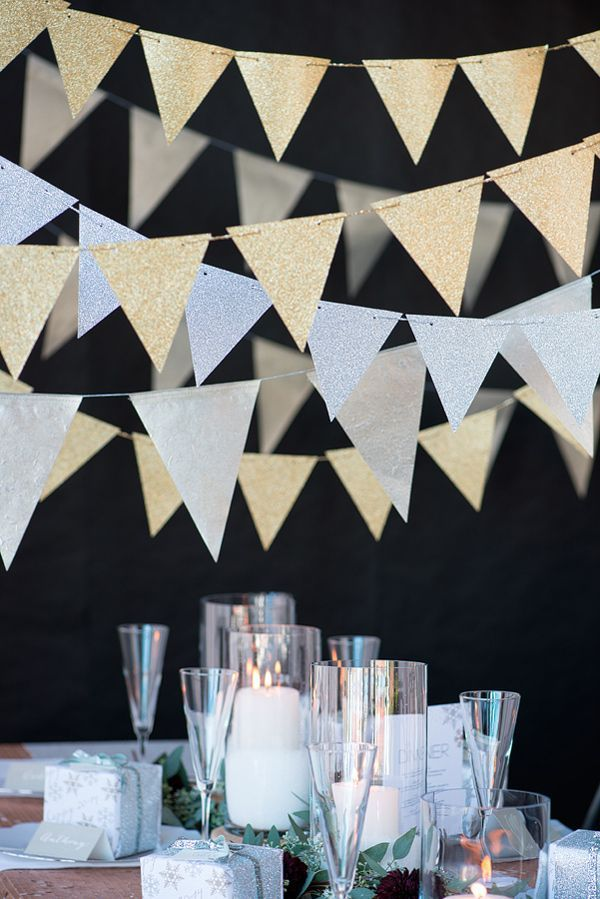 Glittery metallic gold and/or silver bunting carries a lot of visual weight for not that much effort (and even less real estate, if you're short on space). This adds instant drama and shine to a lone wall or makes an inherent focal point a very very festive, well, focal point. Could be created with glitter glued to paper or cardstock and some twine, if you can't find one for purchase.{found on ruffledblog}. #newyear's #2014party #newyearstables