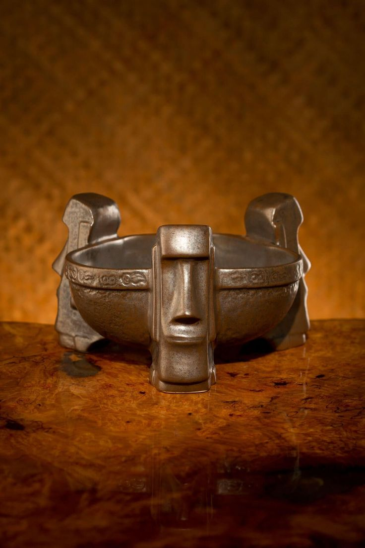 These tikis, modeled after the monolithic Moai of Easter Island, tower over an earthen bowl oasis of your favorite tropical punch. Serving two, this bowl is fit for the tiki gods!