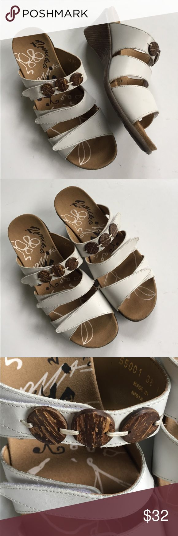 """EUC Romika leather sandals Excellent condition; Beautiful white leather with bead accents; 3 points of velcro adjustability; super comfortable molded footbed - great if you're on your feet a lot; 2 1/2"""" wedge; Romika size 38 which is a 7 - 7 1/2. Smoke-free/pet-free home. Romika Shoes Sandals"""
