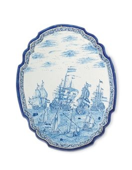 A DUTCH DELFT LARGE BLUE AND WHITE MARITIME PLAQUE  MID-18TH CENTURY  Of elongated shaped quatrefoil form, painted with four hoys before four Dutch warships preparing to arrive at the anchorage, with barrels floating on the waves between them, within a moulded blue-ground border reserved with foliage scrolls, pierced for suspension (very slight chipping to rim, very minor small losses to glaze at extremities), in a modern fitted rectangular travelling-case  22 1/8 in. (56.3 cm.) high