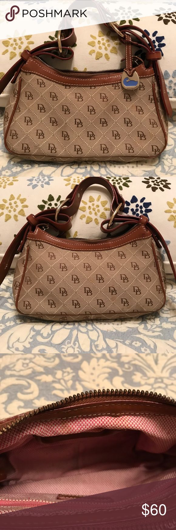 Dooney & Bourke Purse Dooney & Bourke Purse. DB patterned. Brown leather handle. Great condition! Or best offer! Dooney & Bourke Bags