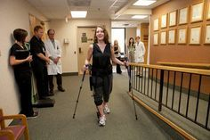 """On Friday, 40-year-old Portage teacher Lisa Curtis became the first person in Michigan to be fitted with a Kickstart Kinetic Device, which will allow her to walk with a """"spring in her step"""" after five years of struggling with mobility."""