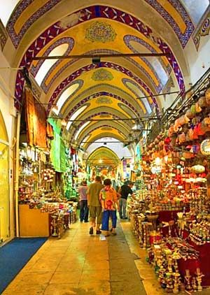 Grand Bazaar, Istanbul, Turkey. The famous Grand Bazaar is one of the world's largest and oldest covered markets.  It's an interesting maze to wander through. With over 4,000 shops, items sold here include gold and silver jewelry, leather jackets, ceramics, pashminas (scarves), rugs, fake designer handbags, belly dancing outfits, lanterns, Turkish nick-knacks and much, much more. #statravel