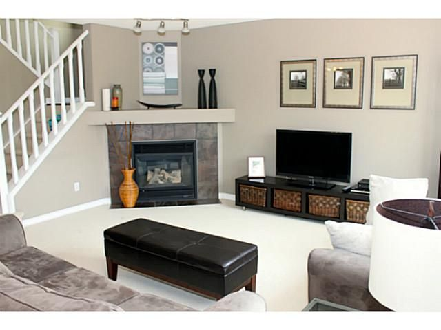Arranging furniture with a corner fireplace arranging for Living room arrangements with fireplace