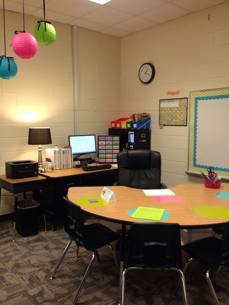 Teachers desk with kidney table. Dry erase circles for kids to practice during small group.