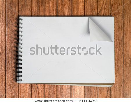 White sketch book one page on Wood table background