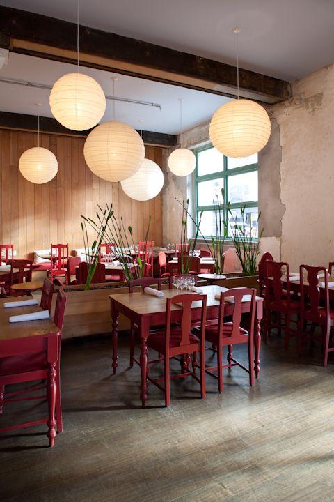 multiple pendants over breakfast bar and dining area/  Cafe Hanoi | Auckland, New Zealand