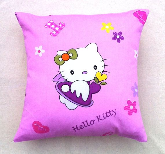 Cushion cover featuring iconic Hello Kitty by RhapsodyInc on Etsy