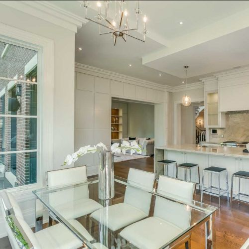 Residential architecture by Toronto architect, Lorne Rose. These images are of a property in the Forest Hill neighbourhood of Toronto. #architecture #toronto #luxury #home #renovation #residentialarchitect #architect #modern #foresthill #interior #design #decoration #interiordesign #interiordecorating #chairs #diningroom #table #flowers #white #wood