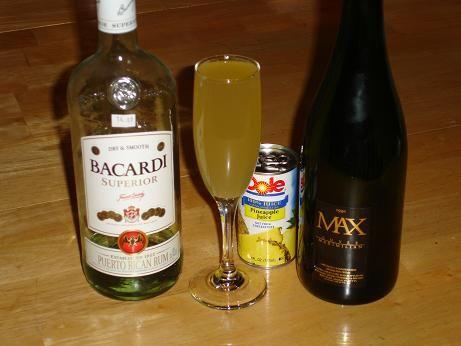 hula cocktail - champagne, rum, pineapple juice