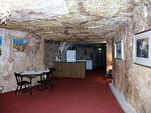 Underground living refers simply to living below the ground's surface, whether in naturally occurring caves or in built structures.
