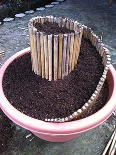 Mini Spiral Garden in a plant container ... would be nice for that big pot by the fire pit.