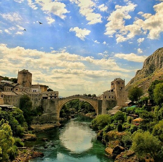 The Old Bridge, Mostar, Bosnia and Herzegovina. The Old Bridge is a reconstruction of a 16th-century Ottoman bridge in the city of Mostar in Bosnia and Herzegovina that crosses the river Neretva and connects two parts of the city. The Old Bridge stood for 427 years, until it was destroyed on 9 November 1993 by Croat forces during the Croat–Bosniak War. Subsequently, a project was set in motion to reconstruct it, and the rebuilt bridge opened on 23 July 2004. Photo by cevriyemuhammed…
