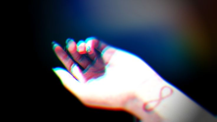 i did not take this.a person i know sent this pic of her hand to show the infinity sign drawn on her wrist. I just edited of the background, darkened it and added a 3D effect to it. :)