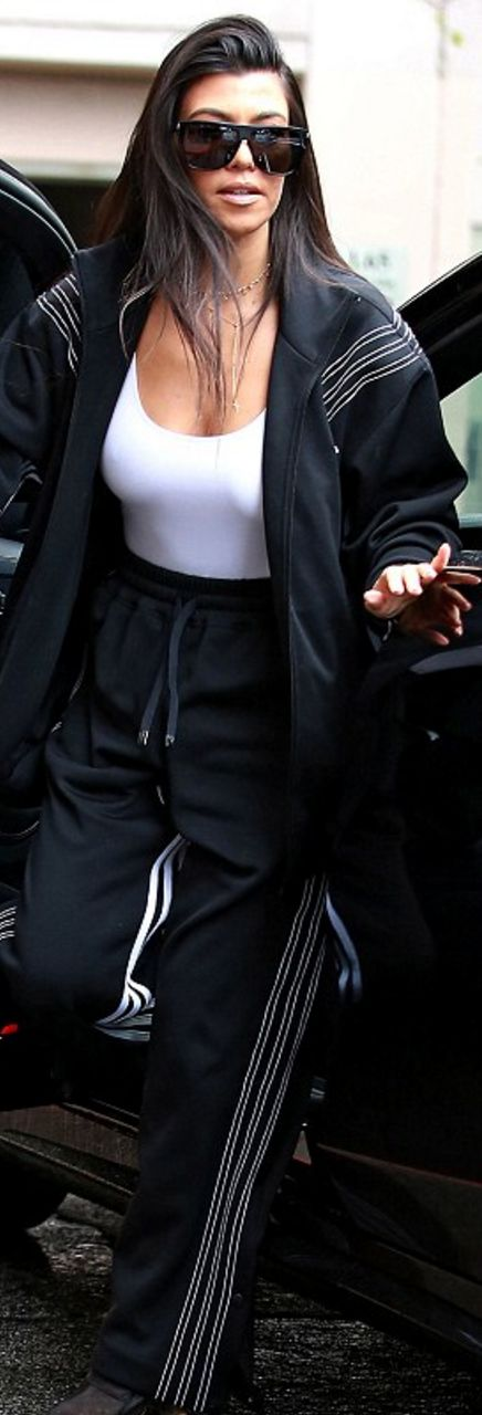 Kourtney Kardashian in Sunglasses \u2013 Saint Laurent Jacket and pants \u2013 Adidas  Shoes \u2013 Yeezy Shirt