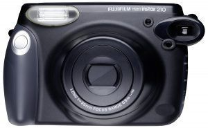 BEST POLAROID CAMERA -     FUJIFILM INSTAX 210 INSTANT PHOTO CAMERA KIT WITH 5 TWIN PACKS OF INSTANT FILM    It is round and has an LCD control panel. It has an auto flash with high resolution for low light shooting. The camera comes with 4 AA batteries. The camera kit comes with five packs of Instax Instant Film.