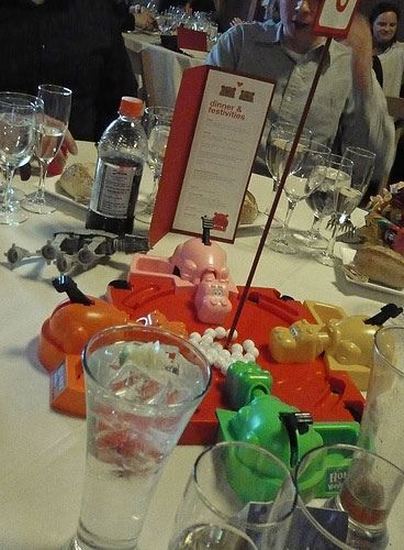 Games as centerpieces.... get your guests to relax and play around a bit!