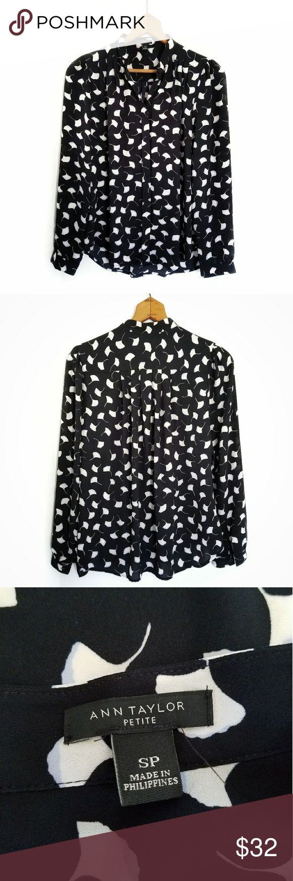 "Ann Taylor black floral dress blouse button front Size Petite Small Bust 21.5"" underarm to underarm Length 25"" Ann Taylor black and white floral print blouse. Long sleeve button front dressy top. Excellent used condition! No holes, stains or wash wear. Ann Taylor Tops Blouses"