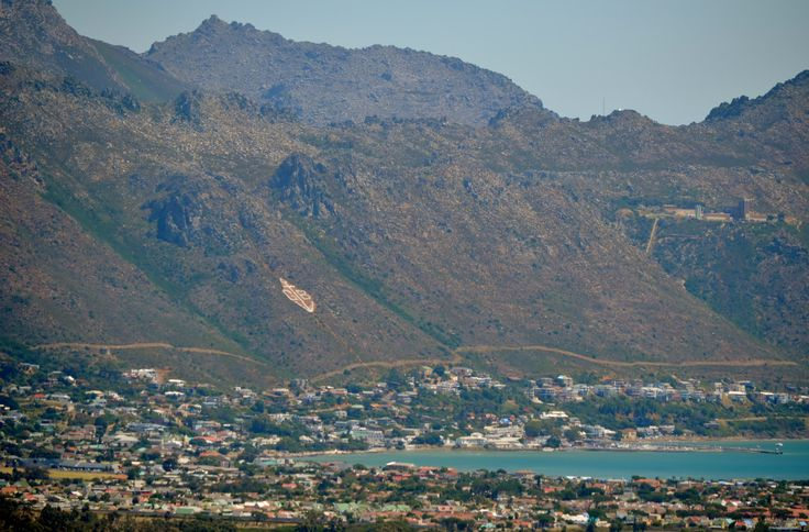 Gordons Bay's residential suburbs around the older central part of the town along the main beach. The gate to Steenbrasdam is visible in the top right of the photo. #GordonsBay
