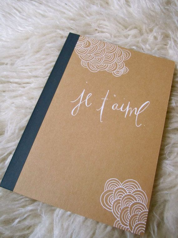 Hand scripted and illustrated cover on kraft brown notebook, white ink design. $14 from Suzyl on Etsy