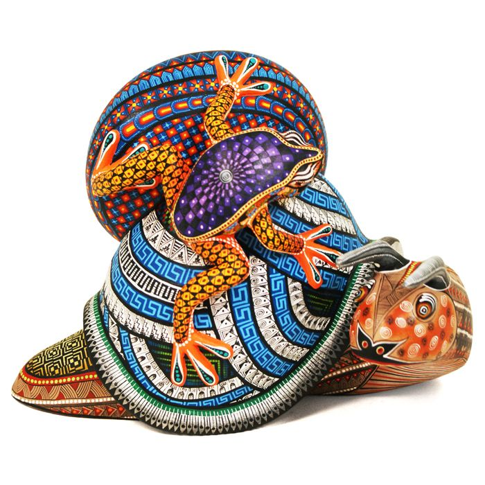Stunning one-piece snail with passenger frog by top Oaxacan artist Manuel Cruz. This wonderful piece is spectacularly painted by Manuel's wife Ruvi, one of the top painters of wood sculptures in Oaxaca. Certainly a museum quality piece!