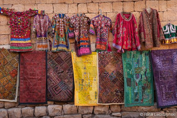 Colourful traditional indian / rajasthani tunics and carpets hanging on the golden / yellow sandstone wall ready for sale on the street of Jaisalmer, The Golden City of Rajasthan, India.   art / boho / asian / photo / wall decor / poster / india  https://www.etsy.com/listing/216816507/colourful-traditional-indian-tunics