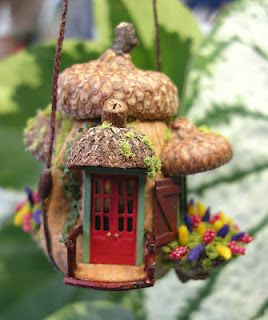 A walnut and acorn caps = cute doll house for the fairies to play with