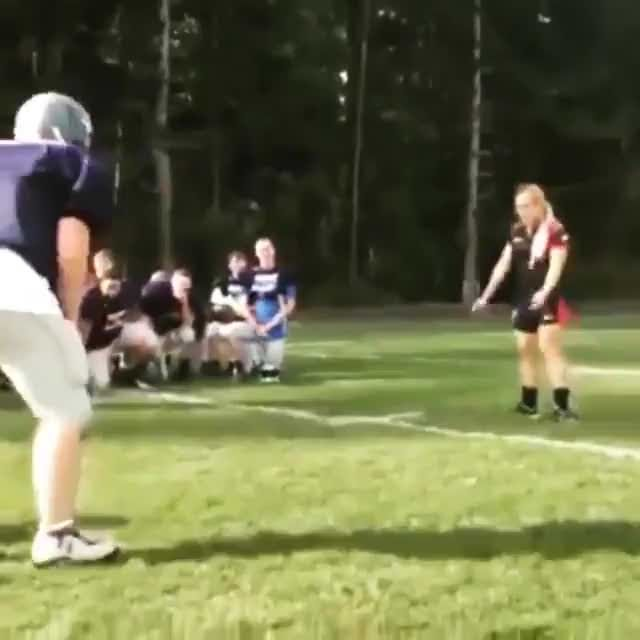 Female Rugby Player vs Male Football Player