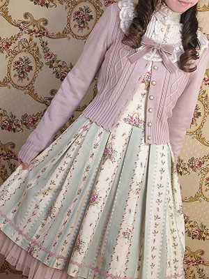 Oh my goodness, this outfit is so darling. I love that sweater and the color combination with the dress is exquisite. ....Can I have this please?