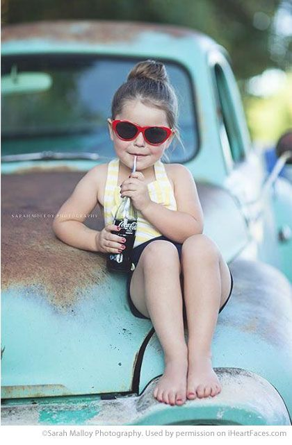 Little Girl in Sunglasses Drinking Bottle of Coke on Old Truck - Photos that Showcase the Innocence of Summer on I Heart Faces Photography Blog