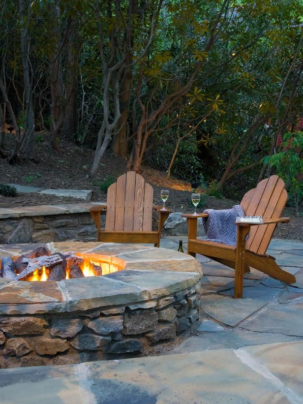 The natural stone fire pit features a Firebrick interior and capped in Pennsylvania Bluestone