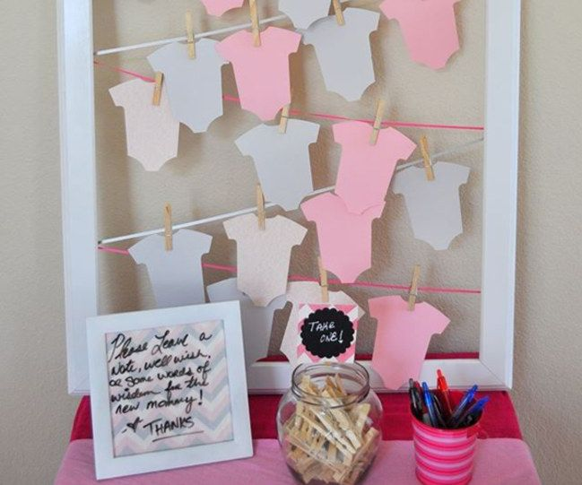 Guest Board - Instead of a standard guest book, welcome family and friends to the baby shower with something a little different. #babyshower