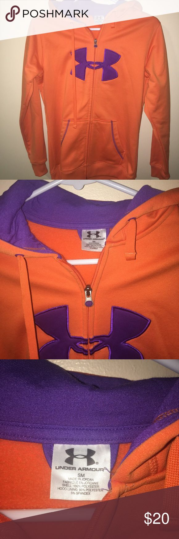 Under Armour Full Zip Up Hoodie Orange Women Small Pre-Owned Under Armour Zip Up Hoodie Women's.  Great for the winter keeps you nice and warm  Orange and purple  Small  Relaxed fit Front kangaroo pockets  100% Polyester  Comes From a Smoke Free Home Under Armour Tops Sweatshirts & Hoodies