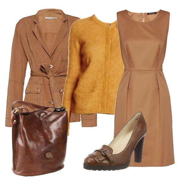Il beige è un colore molto raffinato ed elegante ed è perfetto in qualsiasi occasione. In questo outfit il vestito e la giacca con cintura in vita sono stati abbinati ad un cardigan giallo senape, a delle scarpe in pelle e ad una borsa in cuoio.