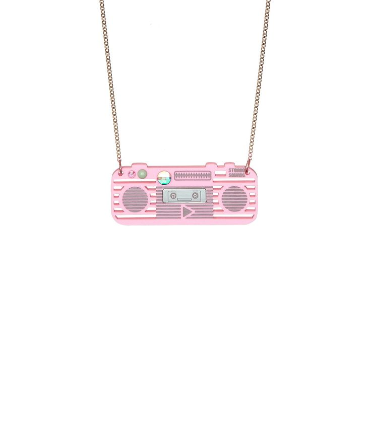 Boombox Necklace - Get the party started with the Boombox Necklace. Laser cut in bubblegum pink acrylic and embellished with a sparkling Swarovski crystal, this ghetto blaster is the perfect piece for any music lover.
