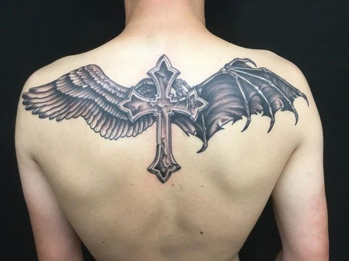 1001 Ideas For A Beautiful And Meaningful Angel Wings Tattoo In 2020 Cross With Wings Tattoo Wings Tattoo Broken Wings Tattoo